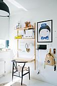 Designer chair at fold-down desk in child's bedroom