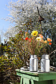 Poppies, dried grasses and fresh branches in old milk churn