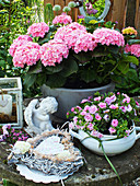 Hydrangea, angel statue, mini petunias, vine heart and candle lantern