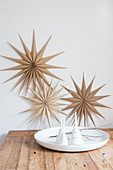 Christmas stars made from wood veneer decorating wall