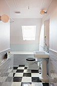 Classic bathroom with vintage-style sink and chequered floor