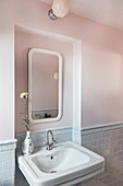 Mirror in niche above sink in classic bathroom