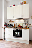 White fitted kitchen with oven