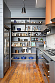 Storage shelf in gray in the masculine kitchen with wooden floor