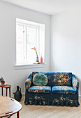 Vintage-style, blue, floral two-seater sofa