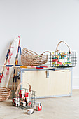 Wooden trunk, wire baskets and raffia baskets for storing toys