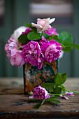 Pink roses in vintage vase