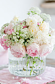 Bouquet of roses and ground elder flowers in pastel shades