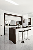 Island counter with bar stools in elegant interior