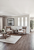 Elegant rattan armchairs, side table and coffee table in living room