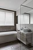 Washstand and bathtub in bathroom