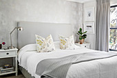 Mottled wall in classic bedroom decorated entirely in grey