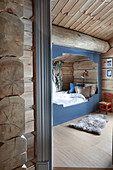 View of cubby bed in bedroom in log cabin