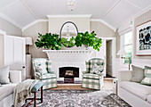 Cottage style living room with checkered upholstered armchairs in front of a white fireplace