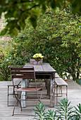 Old garden furniture on wooden deck