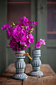 Pink sweet peas in two vases with structured surfaces