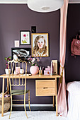 Golden chair at desk against purple wall in child's bedroom