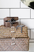 Decoratively stacked sea grass baskets for storing bathroom utensils on washstand