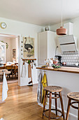 Wooden barstools at kitchen counter