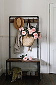 Basket bag with tea roses on vintage wardrobe