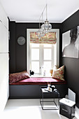 Fitted black window seat with claret-red seat cushion below window