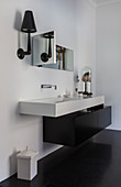 Angular, modern sink with black, floating base unit