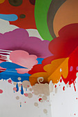 Ceiling painted with multicoloured clouds, droplets and shapes