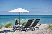 Deck chairs and umbrella on the beach