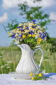 Bouquet of wildflowers in jug