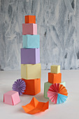 Tower of colourful paper cubes and paper rosettes