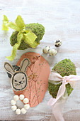 Stitched Easter bunny, modelling clay with botanical imprints and moss eggs