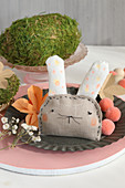Fabric Easter bunny and moss egg decorating table