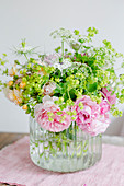 Summer bouquet with roses, lady's mantle and love-in-a-mist