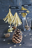 Paper fir trees with pennants on pine cones as name cards
