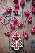 Numbered, red felt Christmas trees and gingerbread biscuit