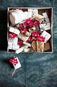 Box of gifts, twine and numbered, red felt Christmas trees