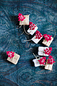 Small gifts with numbered, red felt Christmas trees