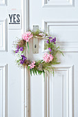 Door wreath made of flowers and seed pods