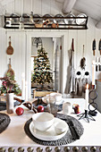 Set table in rustic kitchen with view of Christmas tree