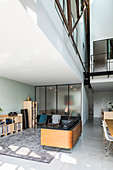 Open-plan interior of masculine loft apartment with steel girders
