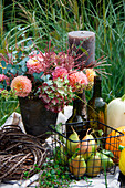 Autumn arrangement with a floral arrangement of dahlias, hydrangea blossoms and Chinese reeds