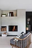 Comfortable armchair in front of fireplace in living room