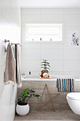 Christmas decorations in bright bathroom with concrete tiles