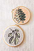 Punch needle leaf motifs in two embroidery frames