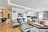 Sofa combination in elegant interior with dining area and kitchen