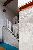 Concrete staircase in open-plan interior