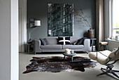 Wintry living room in shades of grey with cowhide rug