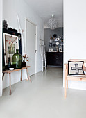 White floor and vintage accessories in foyer