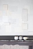 Arrangement of pieces of white wallpaper on wall