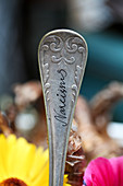 Labelled cutlery used as plant marker
